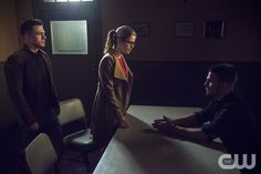 """Arrow -- """"Public Enemy"""" -- Image AR318B_0279b -- Pictured (L-R): Colton Haynes as Roy Harper, Emily Bett Rickards as Felicity Smoak, and Stephen Amell as Oliver Queen -- Photo: Cate Cameron/The CW -- © 2015 The CW Network, LLC. All Rights Reserved.pn"""