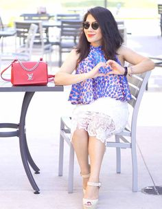 Grace in lace white skirt and printed blue top with red purse