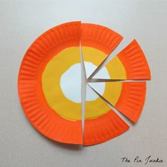 Make a candy corn banner for fall or Halloween with paper plates and paint.  Easy, inexpensive craft.  Great kids craft.
