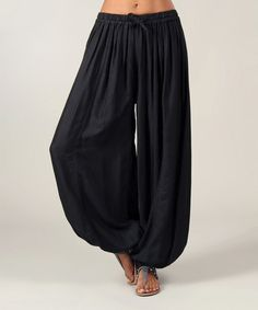 Black Harem Pants. We bought these because we saw them on French women everywhere. Nope, we never wore them once we got home!