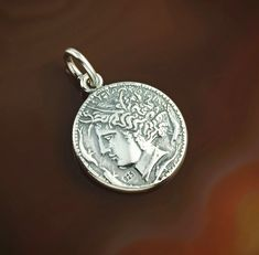 Arethusa coin silver necklace. Arethusa - a beautiful water nymph from Greek mythology - a symbol of feminine energy, a great mystery which is every woman for a man.