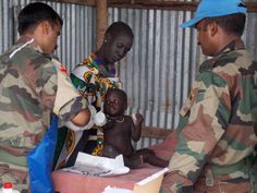 In this photo, peacekeepers from India working in the United Nations Mission in South Sudan (UNMISS) hold a free medical clinic in Pibor, Jonglei State, the scene of recent conflict.
