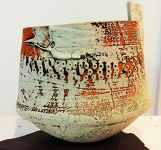 "Lesley McInally - uses printmaking techniques onto clay.  Makes marks, uses  ceramic pigments and hand coloring on porcelain engobes, ""building up layer upon layer and constantly reworking the surface over periods of time thus creating a history of events."""