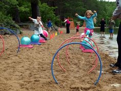 Lake game for kids: Create an obstacle course using hula hoops, exercise balls, and cones