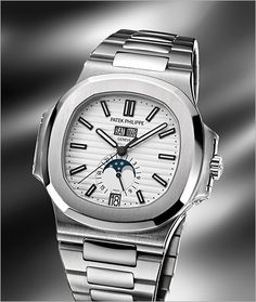Patek Philippe Nautilus Annual Calendar 5127 in WHITE?! One of nicest watches out of BazelWorld this year!!! What a big move for Patek Philippe!