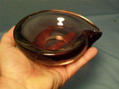 "Asking: $42./7.35   Erickson Ashtray 6.25 inches long. Advertised as ""different purple"" but I think it might be Helio."