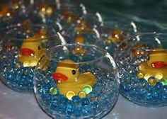 Inexpensive Centerpieces for Baby Shower Ideas - Bing Images....put whales in them instead of ducks