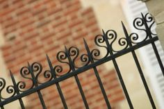 How to Anchor Wrought Iron Fence Posts to Concrete