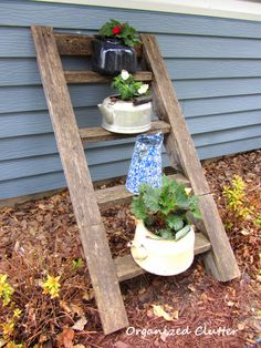 Rescued Tree House Ladder with Tea Kettles. And other great container garden ideas! From organizedclutterqueen.blogspot.com.