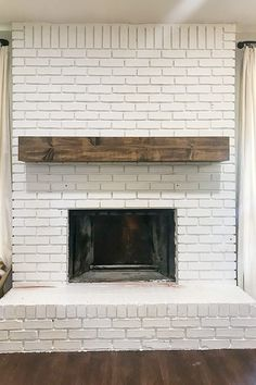 New on Food & DIY: DIY Fireplace Makeover. I love a good before and after! This brick fireplace in our first fixer-upper is one of my favorite makeovers we've done in our house! Gorgeous white paint and farmhouse decor make this brick fireplace pop! The post DIY Fireplace Makeover appeared first on Food & DIY. Update Brick Fireplace, Brick Fireplace Remodel, Painted Brick Fireplaces, Paint Fireplace, Old Fireplace, Farmhouse Fireplace, White Fireplace, Fireplace Design, Fireplace Makeovers