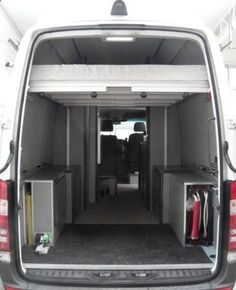 Interior of Peters super-high-roof Sprinter camper van, showing the electric bed in raised position.