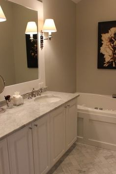 Need to do something with my big, plain, ugly bathroom mirror; frame it?