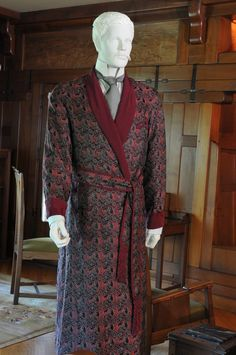 Man's dressing gown, 1905-1915       Throughout the 19th and into the first decade of the 20th century, mainstream formal and business dress for men was a black suit and light colored (often white) shirt paired with a black bow-tie. Constructed from durable wool and lacking all decorative trim, this quasi-uniform was worn across the classes. At home, however, an otherwise soberly dressed gentleman could indulge himself with a richly colored dressing gown
