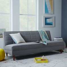 NEW! Design details like gridded tufting, raised seams and an attached seat cushion make the Armless Grid-Tufted Sofa a streamlined choice that doesn't skimp on style. Its gray upholstery pairs well with other neutrals or bright pops of color in living rooms.