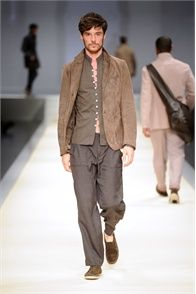 Shorter coat lengths extend the leg and front buttons are slim at Canali this season.