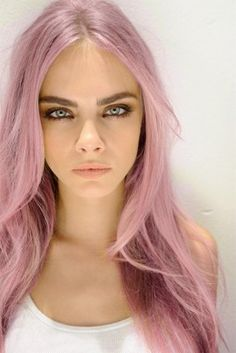 "Accessory Inspiration #1: Cara Delevigne has been seen with this pastel pink hair. The trend of dying your hair in pastel colours such as pinks, blues, yellows and greens strongly reflect the trend of soft pop. The message behind coloured hair shows how woman can express themselves by having unique coloured hair instead of the plain brown, blonde and black ""normal"" hair colours."