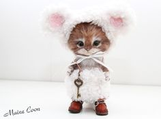 Needle felted cat in little lamb costume.