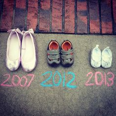 So precious! :)  This could be cute even for the announcement with a pair of newborn shoes and a pair of Liam's current ones... hmmm...  :)  @Brittney Davis