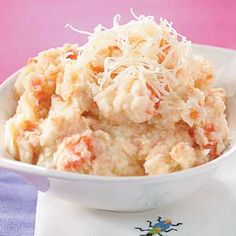 Adding cauliflower and carrot to  mashed potatoes adds nutrients and keeps the calories low for this side dish.