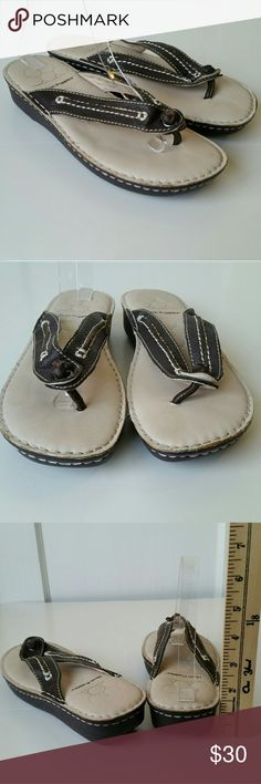 Hush Puppied Leather Cushioned Flip Flops Excellent condition. Super comfy cushioned soles. Dark brown with nude interior.  Slight platform. Hush Puppies Shoes Sandals