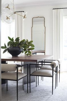 Gorgeous 42 modern minimalist dining room design ideas for comfortable dinner with your family 2 Dining Room Table Centerpieces, Modern Dining Room Tables, Dining Room Design, Dining Rooms, Mirrors In Dining Room, Mirror Dining Table, Modern Dining Room Furniture, Designer Dining Chairs, White Glass Dining Table