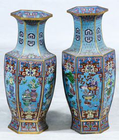 Lot 565: Asian Cloisonne Vases; Pair of contemporary hexagonally shaped vases with a decorative floral urn motif