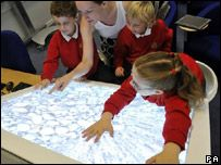 Pupils trying out the interactive desks