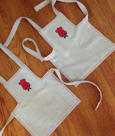 Two matching aprons for little boys