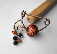 Brass wire wrapped treble clef fibula,pin,brooch with wood bead,carnelian and riverstone