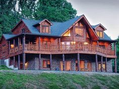 Picturesque custom log home with majestic views sits atop 17 acres. Seldom does a home of this quality and refinement reach the market. You will love the way the setting sun tints the thick logs of this 4500sq ft cabin. Warmth fills its 4BR3BA with wonderful ventless stacked stone fireplace in living room and dramatic family room with built-in bar where you will spend many relaxing hours. The property also contains a guest houseMother-in-law suite a rental home with 3 sufficiency apartments…