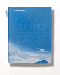 Snowsports Industries America brochure with spot gloss varnish and embossed cover.