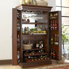 Bar Armoire (Birch Lane | Traditional furniture & classic designs) Great inspiration for repurposing an entertainment center.