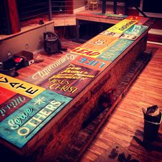 Hand painted sign countertop by Chastin Brand for LifePoint Church Youth room design. Student center.