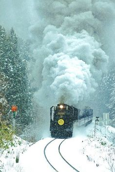 .nothing Quite Compares To A Locomotive With A Full Head Of Steam In A Snowy Setting.