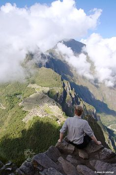 Sitting on a platform near the summit of wayna picchu