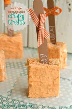 Orange crispy treats are bursting with creamy orange flavor. With one bite will bring you back to memories of a childhood classic! | Little Dairy on the Prairie
