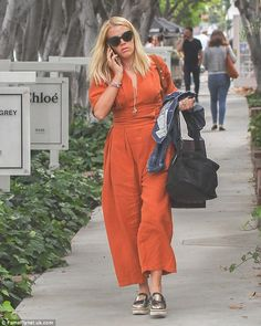 Retail therapy: Busy Philipps enjoyed a spot of shopping in West Hollywood on Thursday, sp...