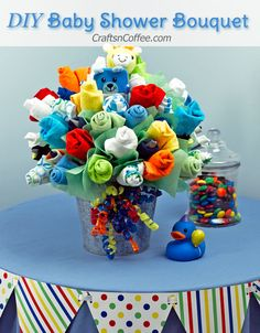 Today we're making a big, bouncing Baby Bouquet! This Baby Bouquet is packed with little goodies every baby needs – bibs, washcloths, socks and onesies. Designer Dina even added two soft rattles. I…