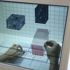 """The computer system would allow humans to interact with digital content in intuitive ways that were never before possible.  The system features a transparent LED display and multiple cameras that track eye and hand movements. Users' hands go behind the transparent screen to use the keyboard and navigate as usual. But thanks to the cameras, the user can also reach up to """"grab"""" perspective-corrected 3D graphics."""