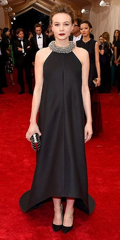 The Most Jaw-Dropping Dresses at the 2015 Met Gala | CAREY MULLIGAN | in a black Balenciaga trapeze gown, with a circular train, silver chain-like collar, Fred Leighton jewels and black clutch.