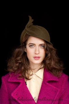 Ingrid is a hand-draped, olive green, fur felt cloche with a beautifully unique, art deco inspired design of upward sweeping lines. Dear Hat