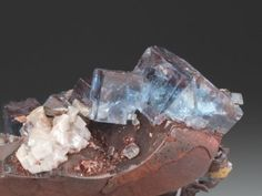 Two blue clusters of Fluorite on Hematite from the Florence Mine, Egremont, Cumbria.  Crystal Classics Minerals