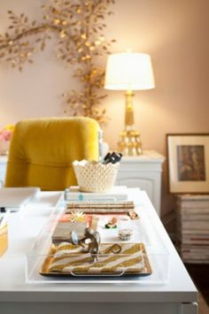 love the color palette, the chair and that gold wall tree branch sculpture!