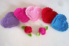 Crochet hearts and roses, done with crochet thread