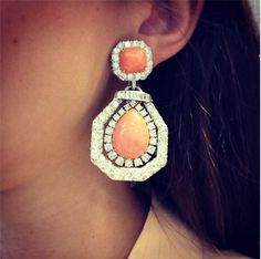 A pair of coral and diamond earrings, by David Webb. #christiesjewels #earrings #DavidWebb