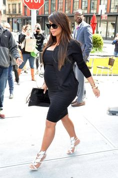 Miss Kim K looks so luxurious in an LBD, black blazer, clutch bag, and silver heels. #maternity #style