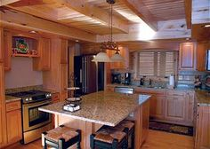 The modern log home kitchen with granite counter tops and stainless steel appliances at Highland's Heaven.