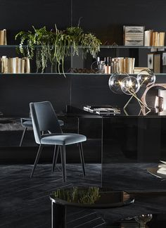Thea, chair with seat and backrest covered by velvet. Black open pore lacquered wooden legs.