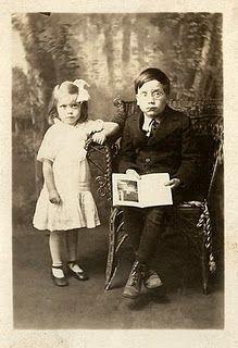 Vintage photo of siblings, serious boy