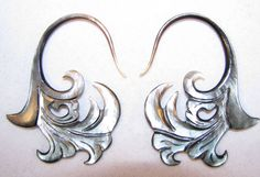 Avaia Artistic Jewelry  - PASSION black shell hanging ear gauges - limited 12g or 2mm spiral taper plugs, $26.99 (http://www.avaiaartisticjewelry.com/passion-black-shell-hanging-ear-gauges-limited-12g-or-2mm-spiral-taper-plugs/)
